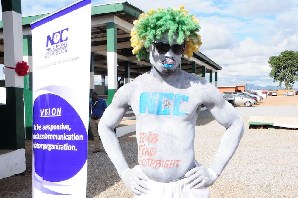 A performer with body and hair painted in different colours was part of the attraction at the Abuja International Fair 2014      Image credit: NCC