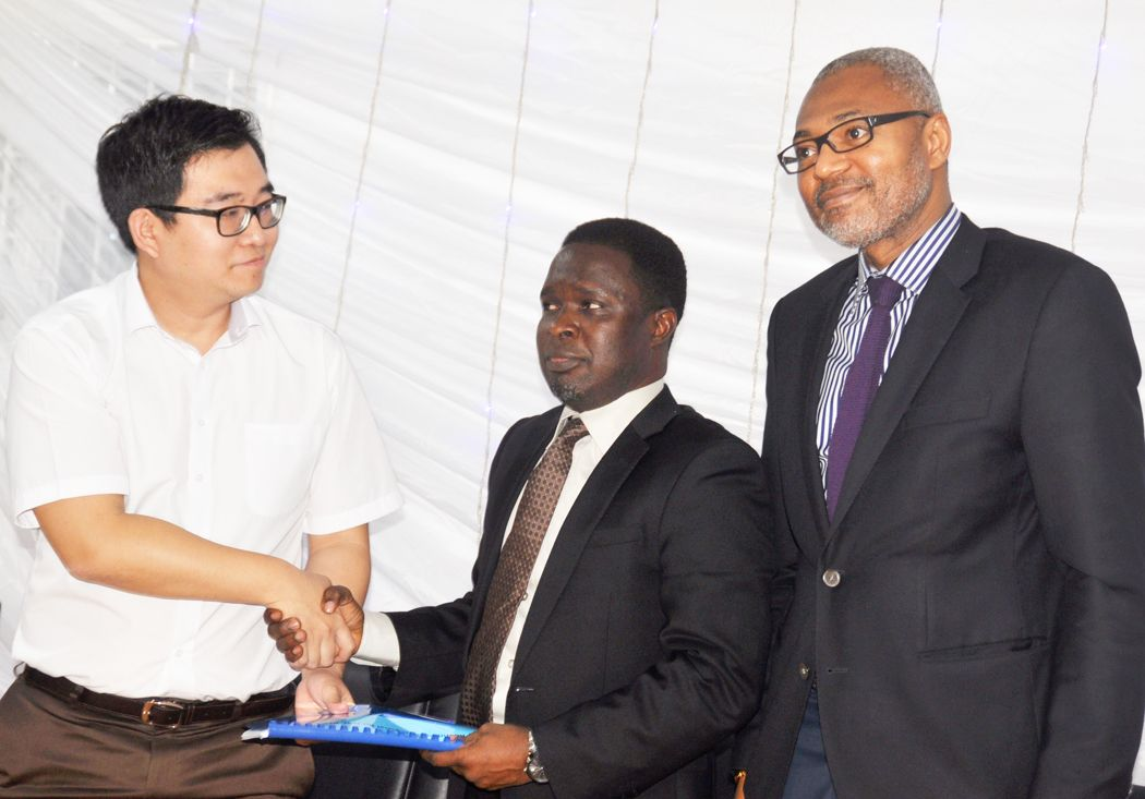 Mr. Young Kang, Sales Director, Africa and Europe, Kaon Media South Korea Limited (left); Mr. Babatope Agbeyo, President/CEO, Media Concepts International (MCI) Limited and Mr. Emeka Mba, the Director General, National Broadcasting Commission (NBC), Tuesday at a world media briefing and signing of MOU agreement  between (MCI and chosen OEM Partner) with National Broadcasting Commission (NBC) in Lagos.