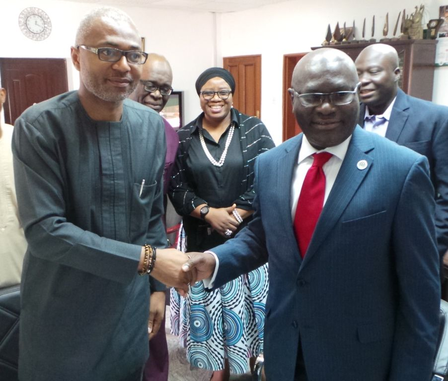 Mr. Emeka Mba, Director General, National Broadcasting Commission (NBC) in a handshake with Secretary General, Commonwealth Telecommunications Organisation, (CTO), Mr. Shola Taylor at the agreement-signing ceremony