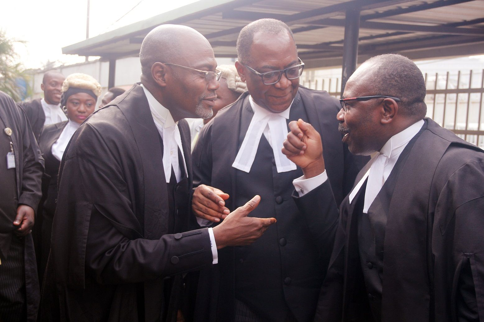 Yusuff Ali (SAN), leading counsel for NCC; Prof. Taiwo Osipitan (SAN) and Dr Muiz Banire earlier today after the hearing MTN vs NCC case held at Federal High Court in Ikoyi, Lagos Photo: Kehinde Shonola/Technology Times