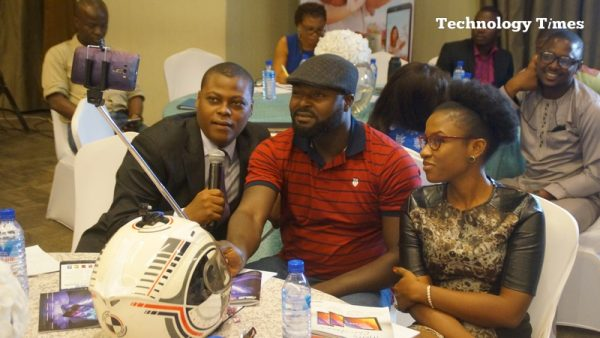 People seen taking selfie at a smartphone launch event in Lagos