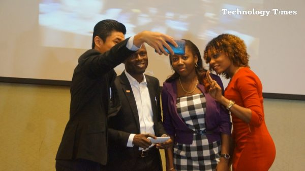 Technology Times file photo shows people seen taking selfies on a smartphone at a phone lauch event held in Lagos