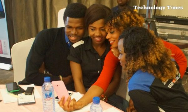 A phone user seen taking selfie with others on a phone camera at an event in Lagos