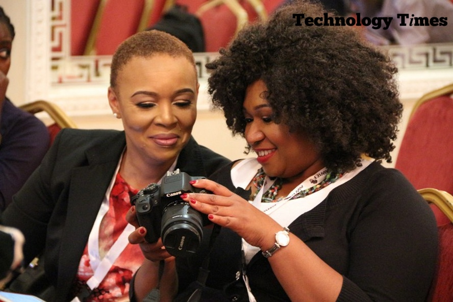Technology Times photo shows two women looking at a DSLR camera at the Africa Women Innovation and Entrepreneurship Forum (AWIEF 2016) held last week in Lagos