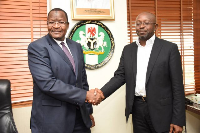 Professor Umar Danbatta, left, in handshake with Mr Boye Olusanya, Chief Executive Officer 9mobile formerly called Etisalat Nigeria