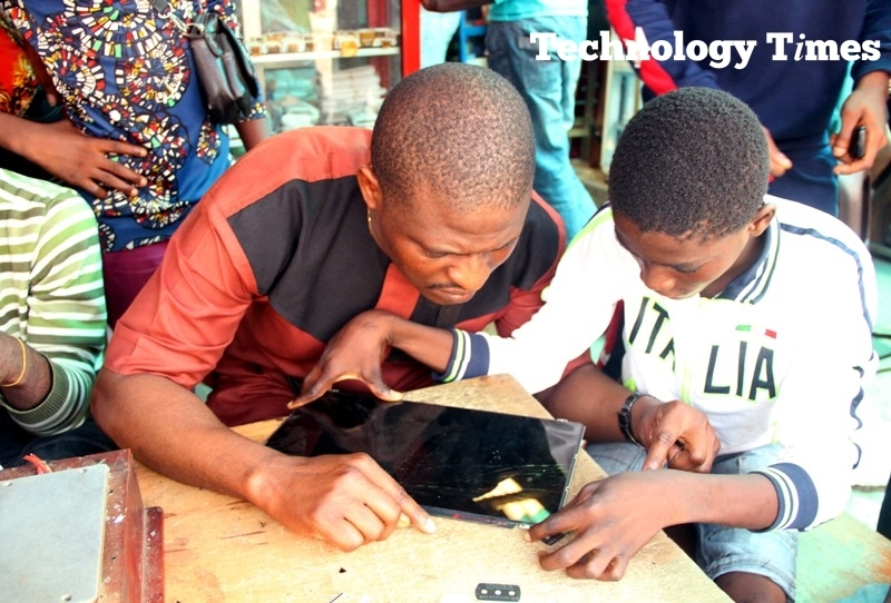 Technology Times file shows a group of mobile phone technicians in Computer Village in Ikeja, Lagos
