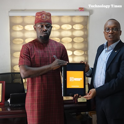 Mr. Shina Badaru, Founder, Technology Times Media Limited, on the left, presents the official logo of Komputer Village Magazine to Mr. Ahmed Ojikutu, President, Computer and Allied Products Dealers Association of Nigeria (CAPDAN) during a recent courtesy visit by Technology Times management to the leadership of CAPDAN in the popular Computer Village, Ikeja in Lagos on the upcoming Komputer Village Magazine, promoting the largest technology market and launching July 1, 2018 across Nigeria.