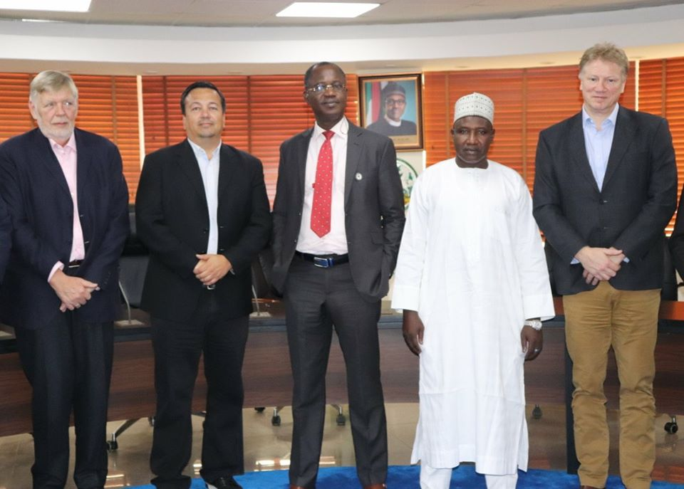The Viasat top management team seen in group photo during a visit to the Nigerian Communications Commission (NCC) in Abuja, showing Engr. Augustine Nwalunne, Director, Spectrum Administration at the telecoms regulatory agency in the middle.